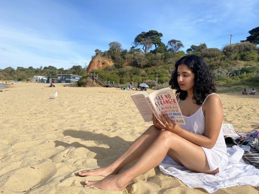 Me reading Valarie Kaur's Book